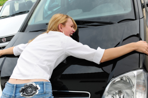 woman is really happy with her new car
